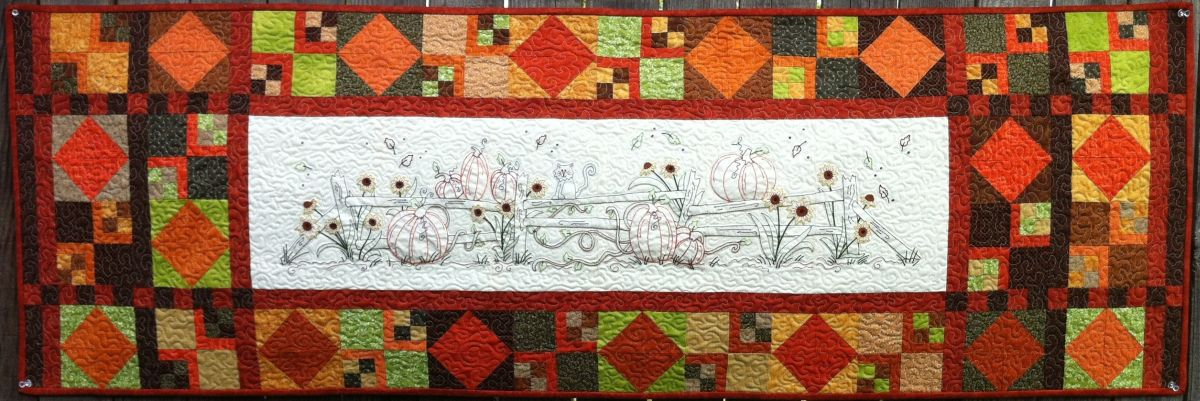 Embroidery this country fence and enjoy the colors of fall then add